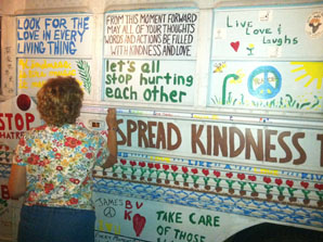 Joan Marie painting kindness bus